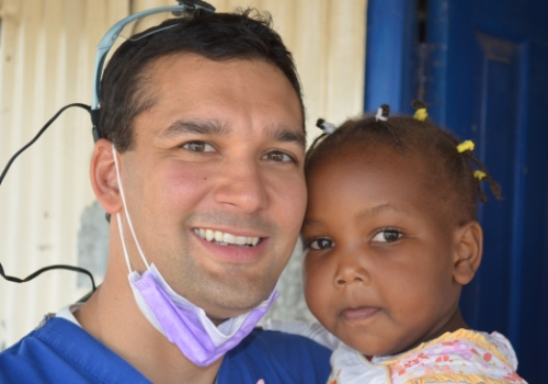 Mission Trip - Dr. Vostatek with little girl