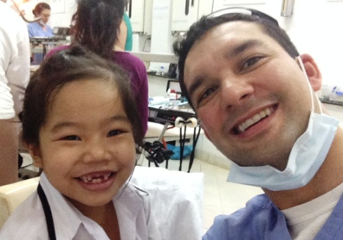 Mission Trip - Dr. Vostatek with smiling girl