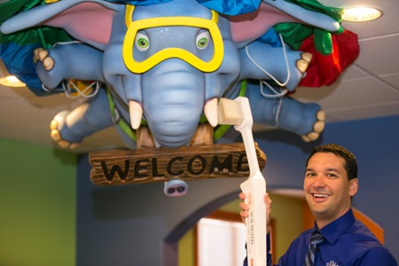 Pediatric Dentist in Colorado Springs, CO Dr. Sean Vostatek with the ceiling artwork