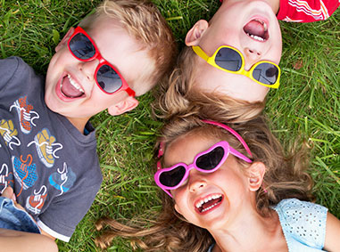 Smiling kids with sunglasses